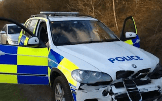 Thug in flatbed truck rams brand new BMW X5 police vehicle