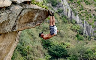 Cliffhanger! Upside-down daredevil uses feet to cling to cliff