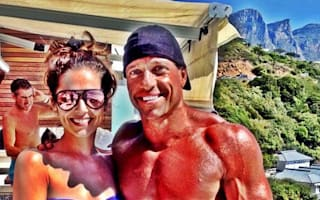 Cheryl Cole poses with topless hunk on holiday in Cape Town