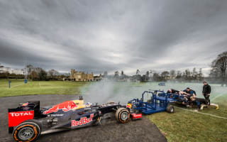 Red Bull racing car takes on Bath rugby stars