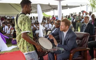 Harry takes to the drums and deploys dancing skills in charm offensive