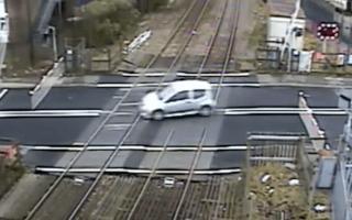 Car filmed dangerously swerving across railway tracks