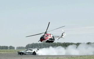 Drift car goes head-to-head with aerobatic helicopter