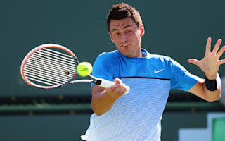 Top seeds Tomic and Karlovic sent packing