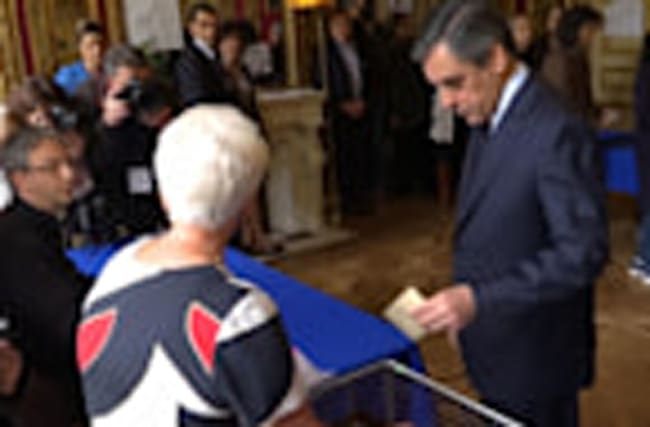 Conservative candidate Fillon casts vote in French election