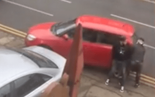 Motorist blocks in car parked on her driveway