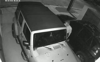 CCTV footage captures man stealing Jeep using laptop