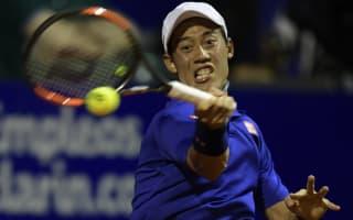 Nishikori, Isner battle into quarter-finals