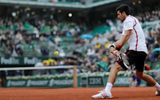 Djokovic holds slender lead as play is suspended
