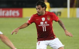 Guangzhou Evergrande Taobao 2 Jiangsu Suning 0: Goulart double seals Super Cup win