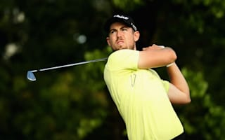Holman holds slender lead in Malaysia