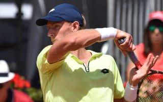 Anderson ousts Lorenzi in Geneva, Simon through in Lyon