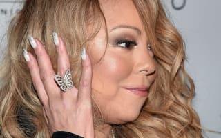 Ooh-la-la! Mariah Carey stuns in saucy suspender outfit