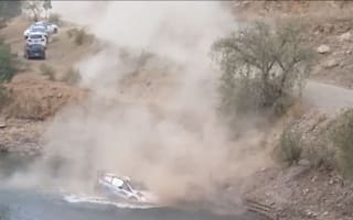 Video: Rally duo escape car as it sinks into lake