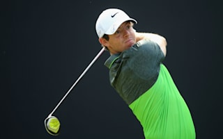 Sullivan retains lead as McIlroy closes in