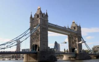 Helicopters fly through Tower Bridge