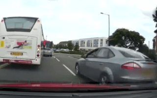 Shocking moment a motorist overtakes stationary traffic on the wrong side of the road