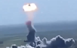 Suicide bomber's car flung into the sky before detonating mid-air