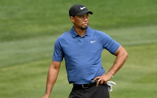 Woods cancels news conference over back problems