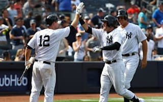 Yankees earn share of AL East lead, Santana stars