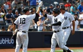 Yankees earn share of AL East lead, Santana stars