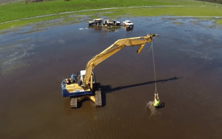 Australians turn digger into wakeboarding ride