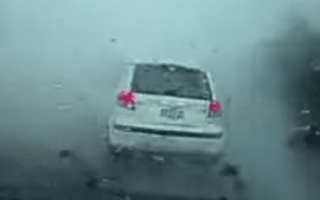 Tornado tears car up and off the road