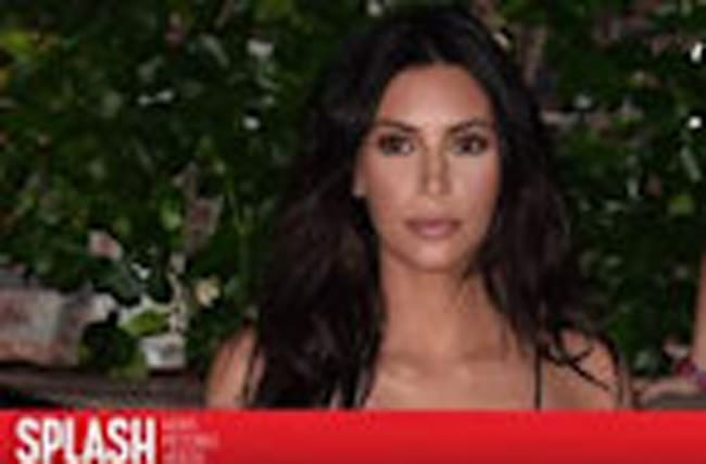 Kim Kardashian Threatens Lawsuit to Author Who Says Her Robbery was 'Staged'