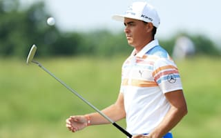Fowler shoots record-equalling 65 to lead U.S. Open by two