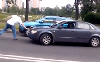 Russian motorist attacks car with axe in road rage incident
