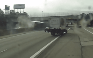 Careless driver causes lorry to flip over on Detroit highway