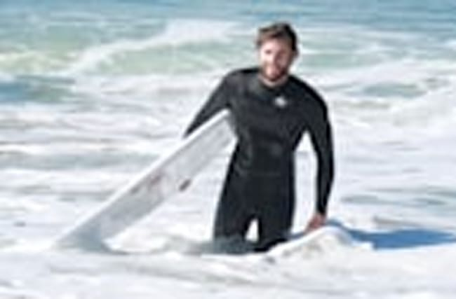 Liam Hemsworth Smiling in a Wetsuit Is the Only Photo You Need to See Today