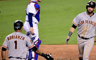 Giants overcome Dodgers, Rangers close in