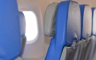 Who should get the armrest in the middle seat on a plane?