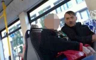 Adolf Hitler lookalike carries copy of Mein Kampf and charges tourists £60 for a photo