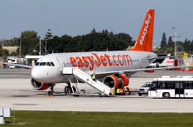 Woman kicked off flight over abuse of fellow passengers