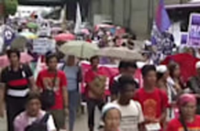 Protesters clash with police in the anniversary of a bloodless revolution in the Philippines