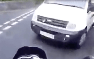 Sickening video shows biker thrown into the air in van crash