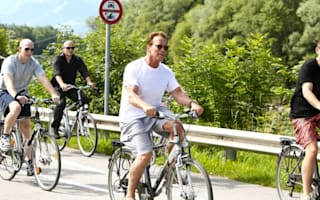 On your bike! Arnie gets back to nature in Salzburg