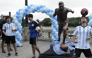 Statue of Argentina and Barcelona star Messi cut in half