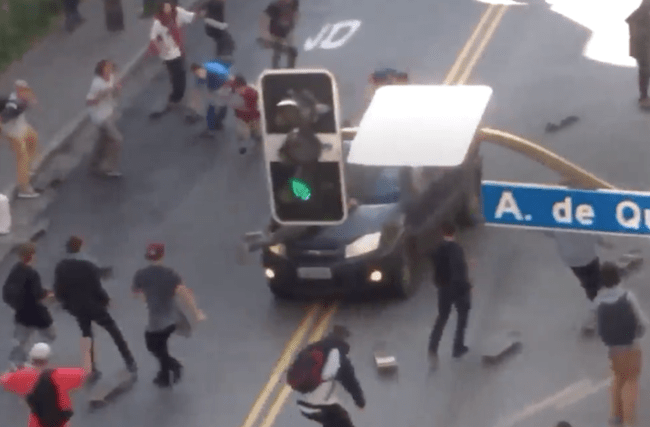 The horrifying moment an SUV ploughs into a crowd of skateboarders