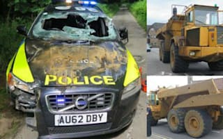 Low-speed dumper truck chase sees two police cars destroyed