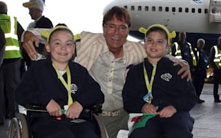 Sir Cliff Richard sings Summer Holiday on charity flight to Florida