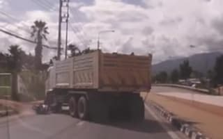 Scooter rider has lucky escape after falling under lorry