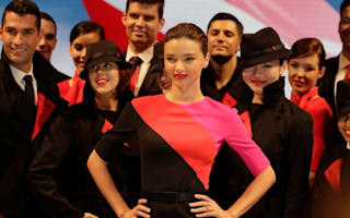 Qantas cabin crew upset with 'impractical' new uniforms modelled by Miranda Kerr