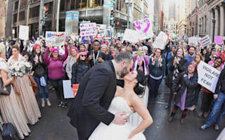 Incredible wedding photo of couple on women's march