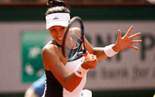 Muguruza marches on at Roland Garros