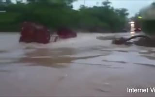 Truck driver tries to slow floodwaters with his lorry