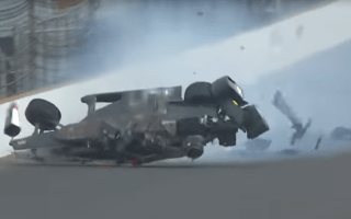 IndyCar racer hits the wall during Indianapolis 500 qualifying