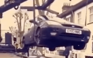 Motorists prevent their car from being towed by sitting in it